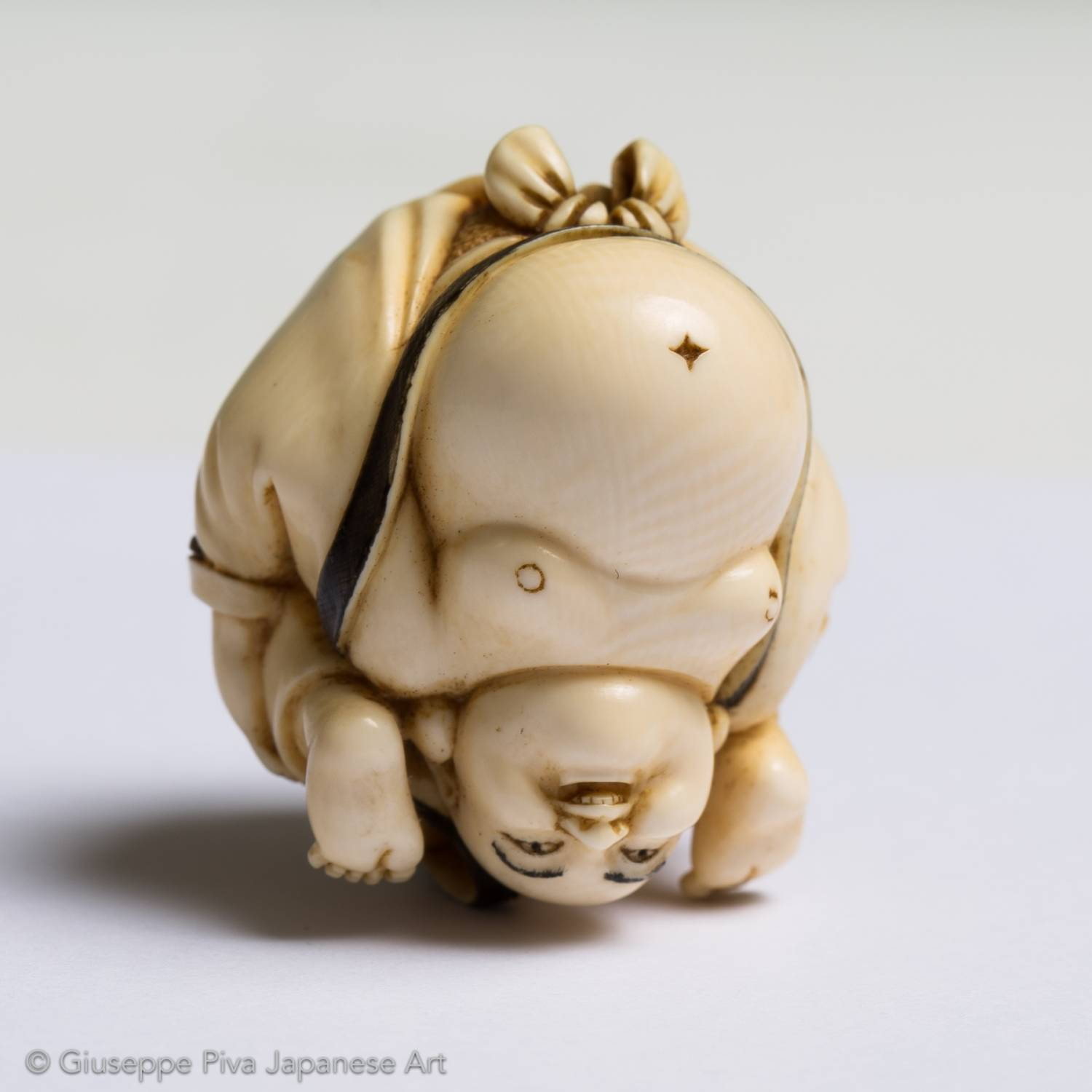 Ivory netsuke with Hotei